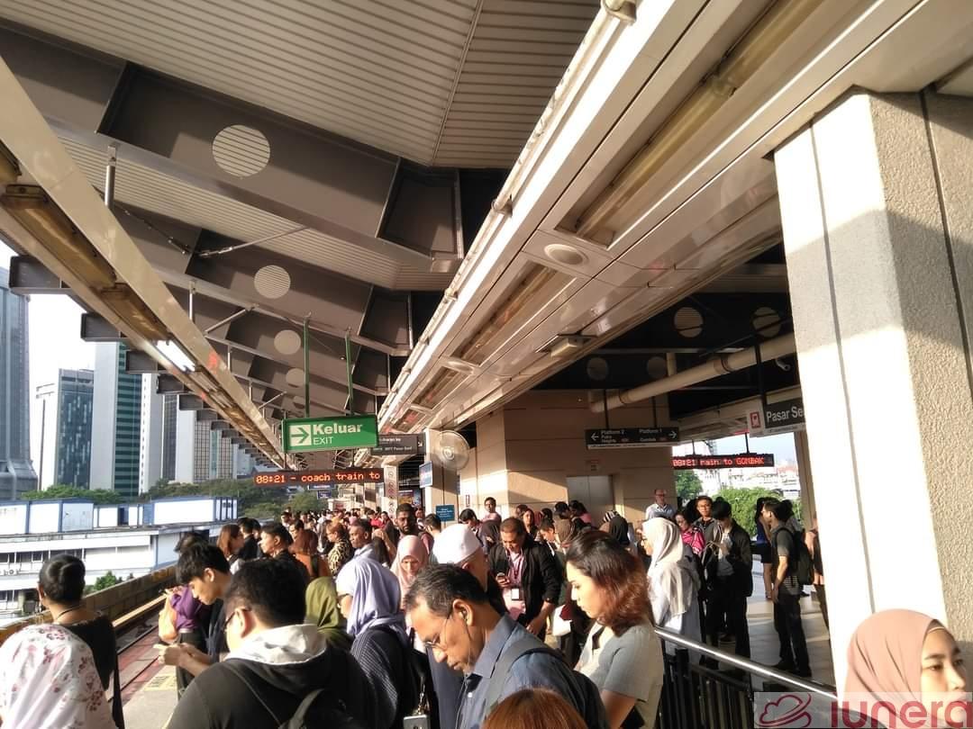 A crowded train platform at the Pasar Seni LRT station in Kuala Lumpur, Malaysia.